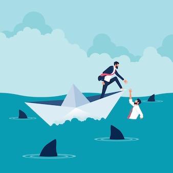 他のビジネスマンを助ける海で紙の船に乗っているビジネスマンビジネスチームワーク支援とサポート