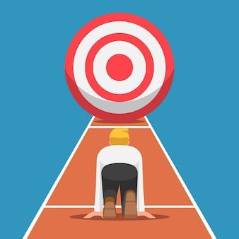 Бизнесмен на отправной точке и готов бежать в цель. бизнес-цель и концепция начала карьеры.