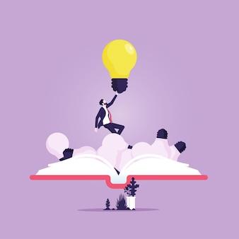 ビジネスマンの開いた本は、教育プロセスで光る電球の使用情報通信技術を上げます