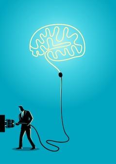 Businessman plugs a brain