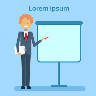 Businessman pointing to empty white board