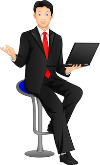 Businessman posing and holding laptop
