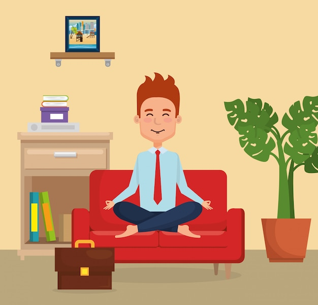 Businessman practicing yoga in the sofa
