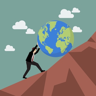 Businessman pushing the world uphill