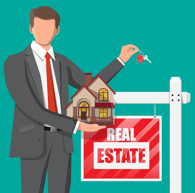 Businessman or realtor holding house and key