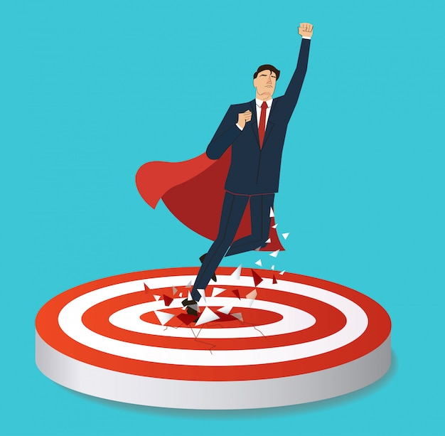 Businessman and red cape breaking target archery