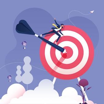 ビジネスマンはダーツに乗ってターゲットビジネスの成功の概念