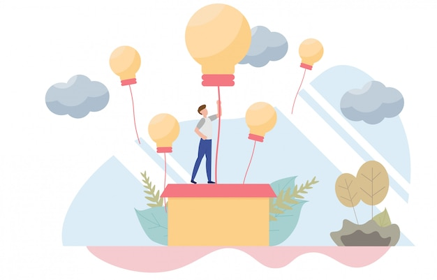 Businessman rising on bulb balloon concept