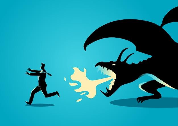 ドラゴンから離れて走っているビジネスマン