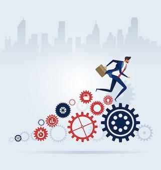 Businessman running on cogwheels. process concept