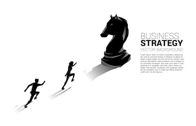 Businessman running to knight chess piece