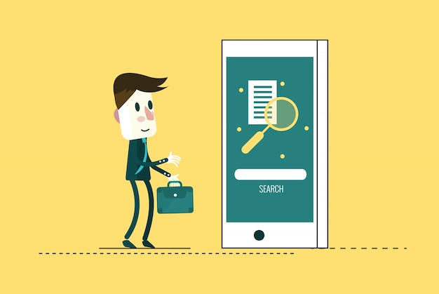 Businessman searching on mobile phone