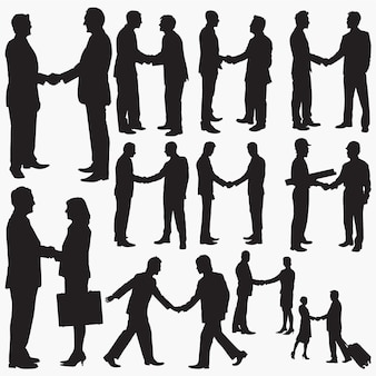 Businessman shaking hands silhouettes
