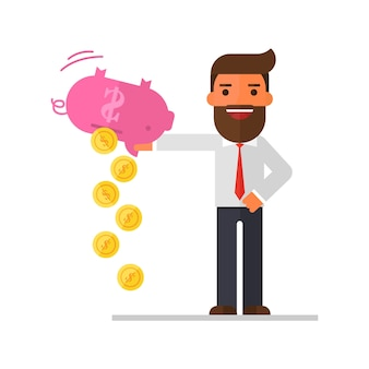 Businessman shaking money from piggy bank