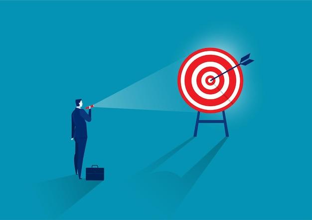 Businessman shining light on target. focusing on a new marketing target
