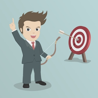 Businessman shoot an arrow to target.