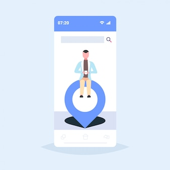 Businessman sitting on geo pin tag pointer man holding cellphone using mobile navigation app location marker gps position concept smartphone screen  full length