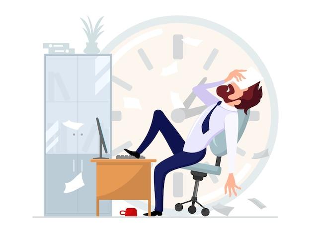 コンピューターの机の上に足を置いてオフィスの椅子に寄りかかって座っているビジネスマン