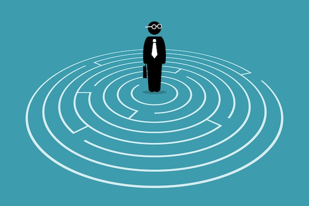 Businessman standing in the center of a maze.