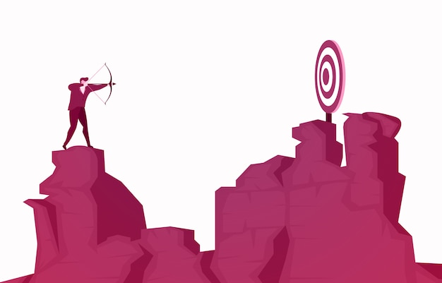 Businessman standing on cliff aiming success target with arrow