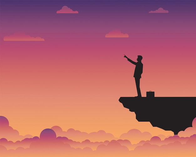 Businessman standing on cliff