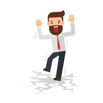 Businessman standing on cracking floor
