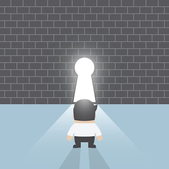 キーホールの前に立っているビジネスマン