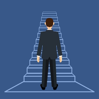 Businessman standing on ladder or stair