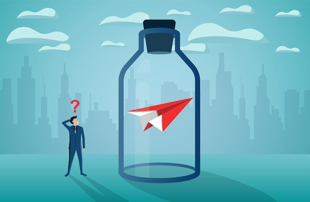 Businessman standing looking the red paper plane stuck in a glass bottle