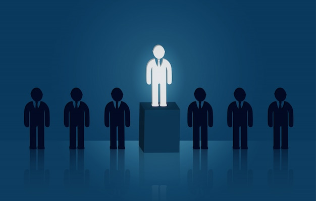 Businessman standing in the midst of people. there is a bright light out. leadership