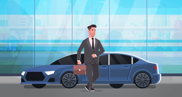 Businessman standing near luxury car man in suit holding suitcase going to work business