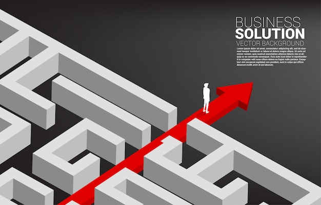 Businessman standing on red arrow route break out of maze. business concept for problem solving and solution strategy.