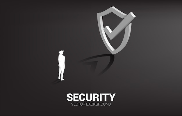 Businessman standing with 3d protection shield icon. concept of guard security and safety