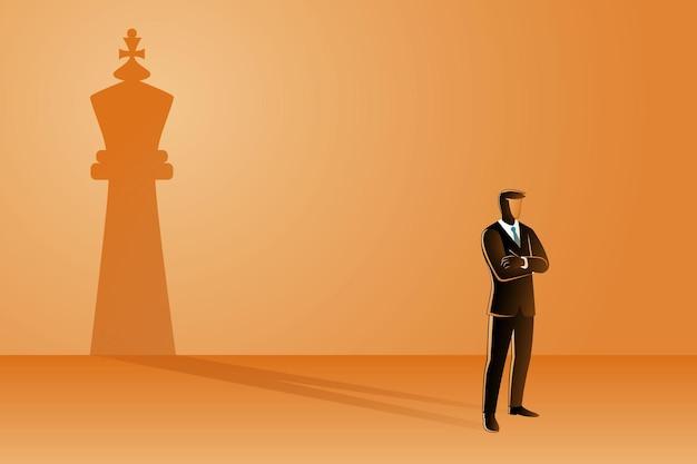 킹 체스 그림자와 함께 서있는 사업가
