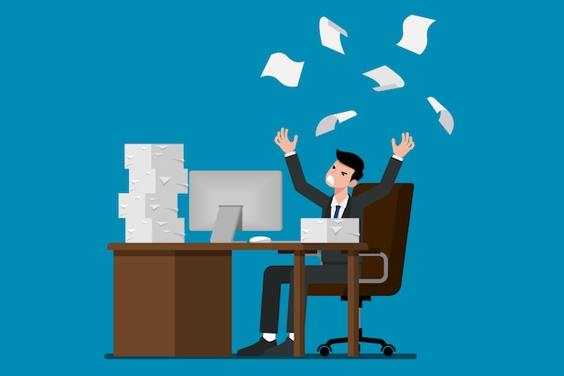 Businessman throwing stack of paper in the air