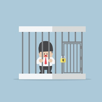 Businessman trapped in a cage