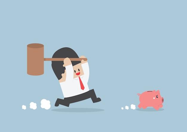 Businessman try to smashing piggy bank