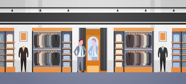 Businessman trying on new business suit
