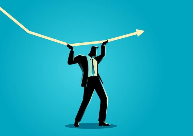 減少するグラフィックチャートを保持しようとしているビジネスマン
