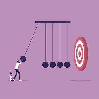 ビジネスマンはニュートンのゆりかごを使用して目標を達成するために影響を与える、成功ベクトルの概念に影響を与える