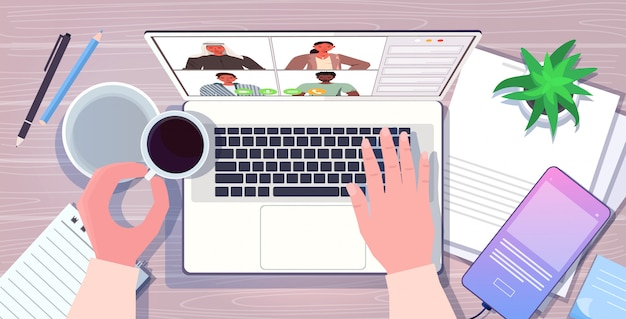 Businessman using laptop chatting with mix race colleagues during video call online conference meeting communication concept workplace desk top angle view horizontal illustration