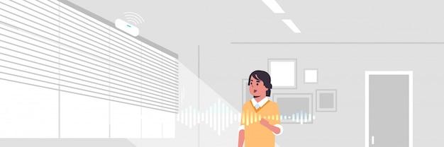 Businessman using smart speaker voice recognition