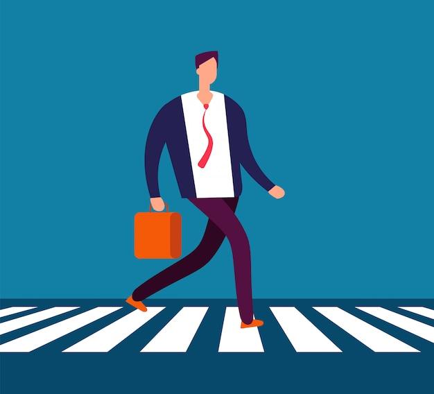 Businessman walking crosswalk