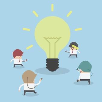 Businessman walking to light bulb to get idea, idea concept