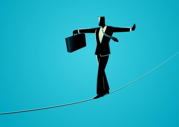 青で隔離のロープを歩くビジネスマン