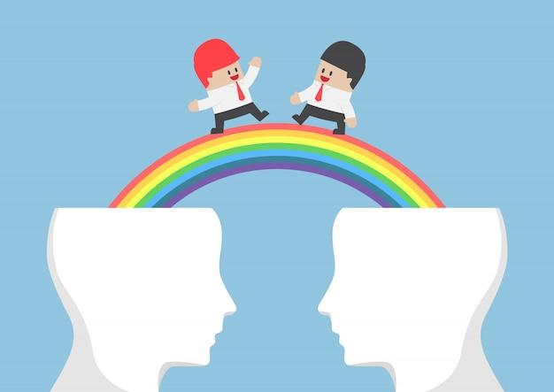 Businessman walking on rainbow from head