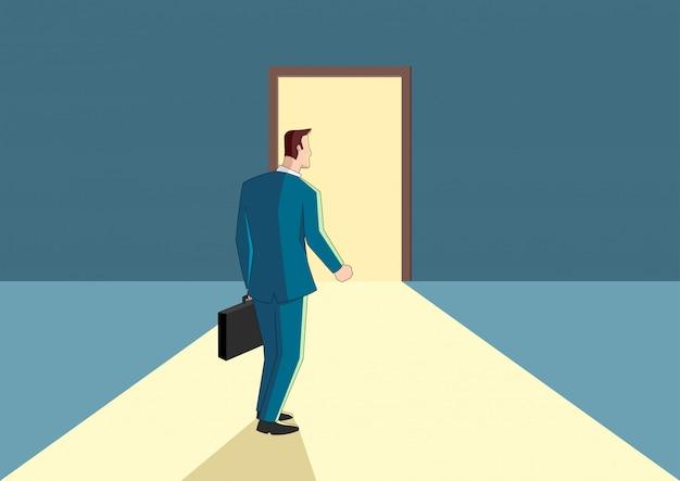 Businessman walking towards a bright door