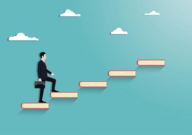 階段本の上を歩くビジネスマン