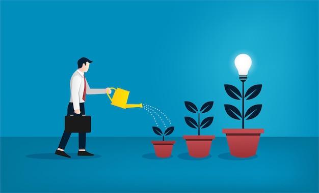 전구 개념의 나무를 급수하는 사업가. 성장하는 새로운 아이디어와 창의성 상징