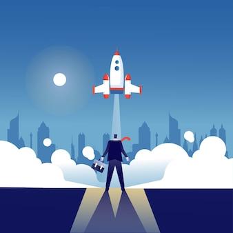 Бизнесмен, который смотрит символ запуска ракеты запуска бизнеса